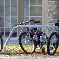 A bike rack at Western University is full of bicycles locked to the rack.